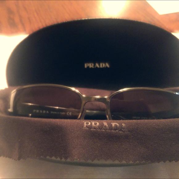 4ec38ea6bf8ed Prada Men s Sunglasses Model SPR53F Black Silver. M 5a6bc522fcdc31e70cd486d6